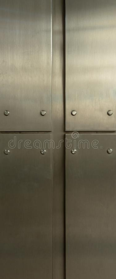 Metallic plates with rivets stock photography