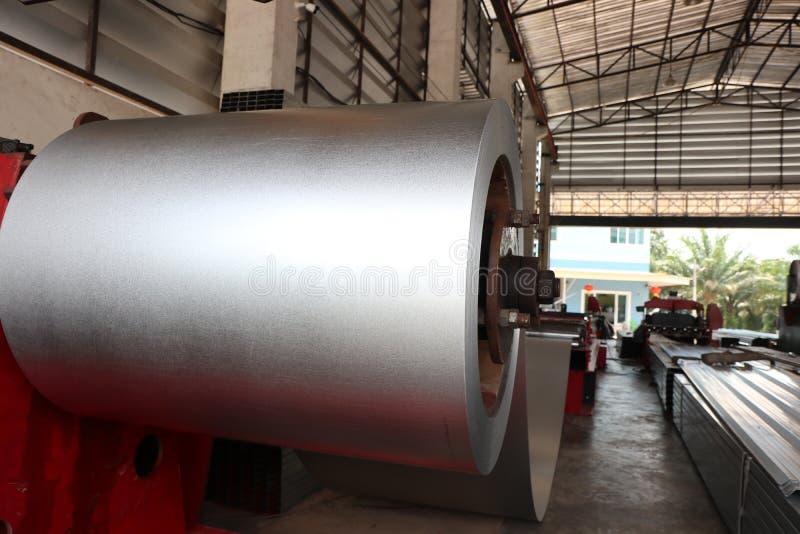 Steel in metal sheet rolling machine ; for tile manufacturing. Coiled steel in metal sheet rolling machine ; for tile manufacturing stock photography