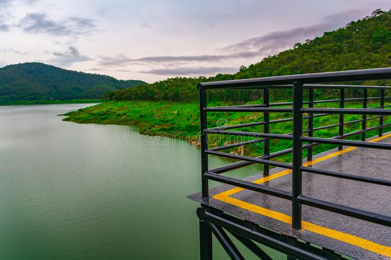 Steel, metal terrace in a beautiful view of lake, mountain and c stock image