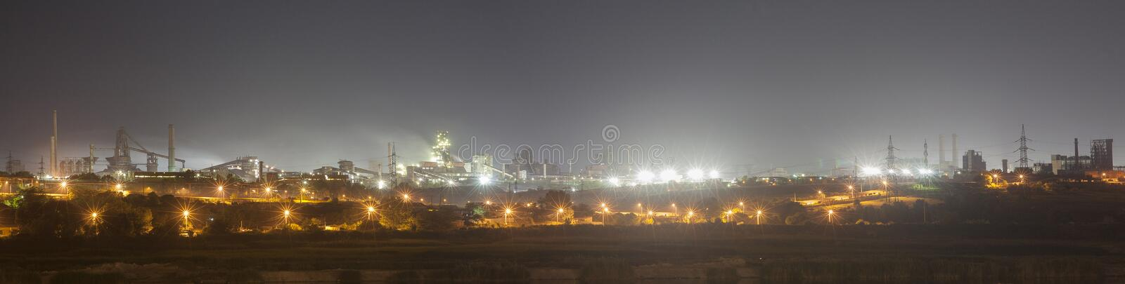Steel mill factory by night stock photo