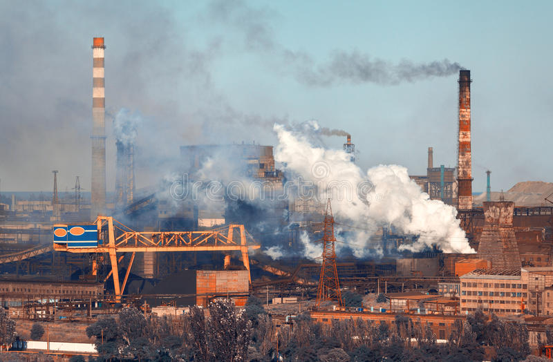 Steel mill, Metallurgy plant. Heavy industry factory. Steel factory with smog. Pipes with smoke. Metallurgical plant. steel works, iron works. Heavy industry stock photo
