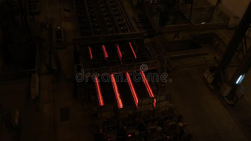 Steel mill plant. Metal tube production line at metal factory. Hot steel pipe production line. Metallurgy. Rolled metal stock photos