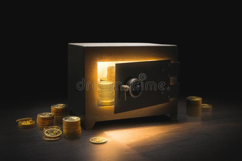 Steel bank safe on a dark background royalty free stock images