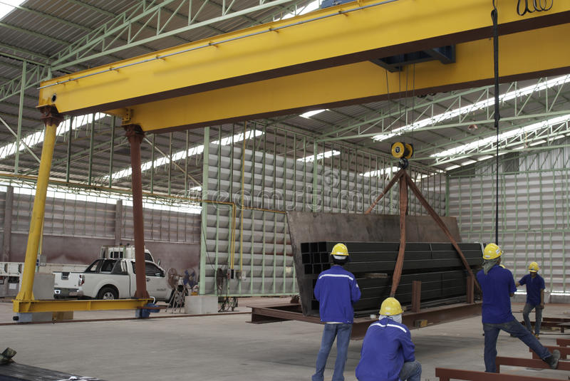 Steel moving with gantry crane. In factory stock photography