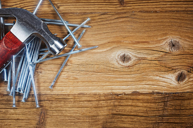 Steel nails on old wood stock image