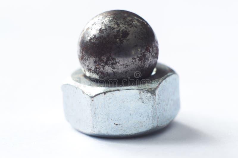 Steel nut on white macro. Iron tool nut on a white background royalty free stock photo