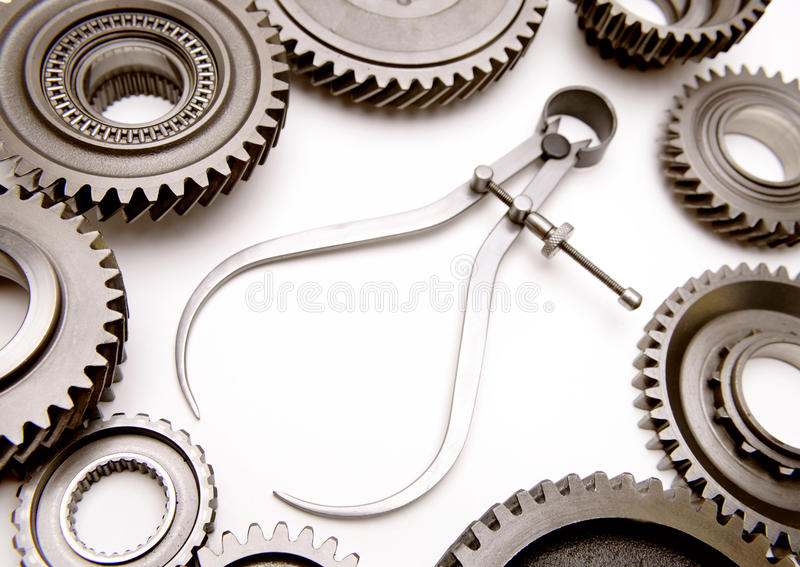 Steel parts. Calipers and cogwheels on plain background royalty free stock images