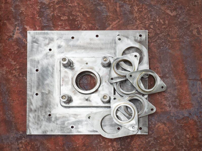 Steel parts on factory floor stock image