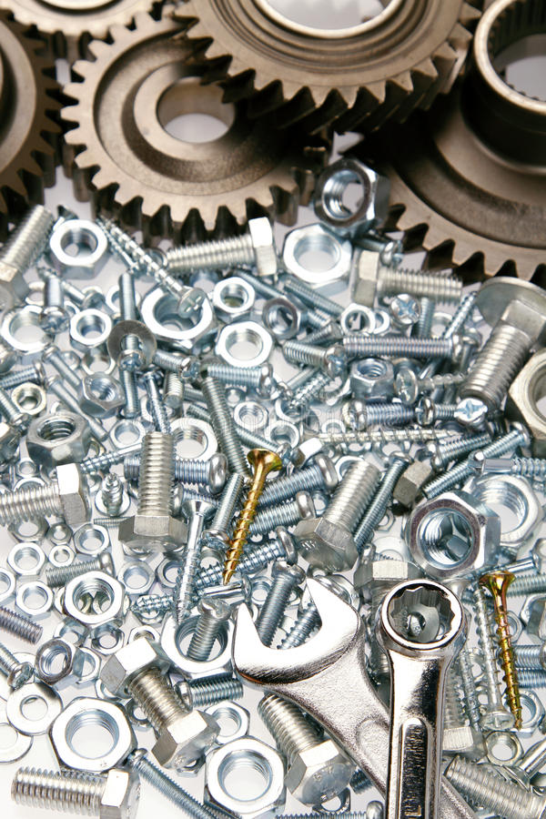 Steel parts. Steel gears, nuts, bolts, and wrenches stock image