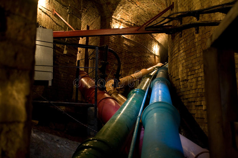 Steel pipe. Old steel pipe in underground tunnel stock photography