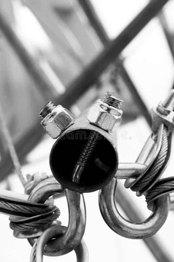 Steel pipe cable art. An image of steel pipe art held together with cables stock photography