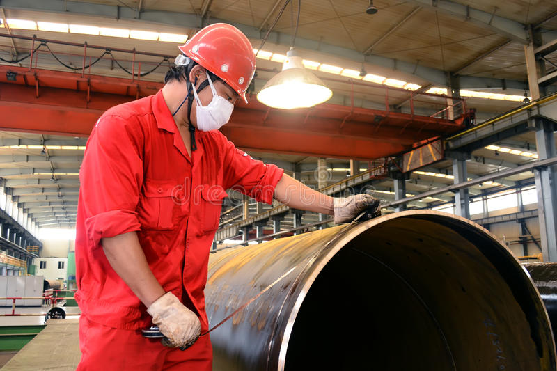 Steel pipe inspector stock photography