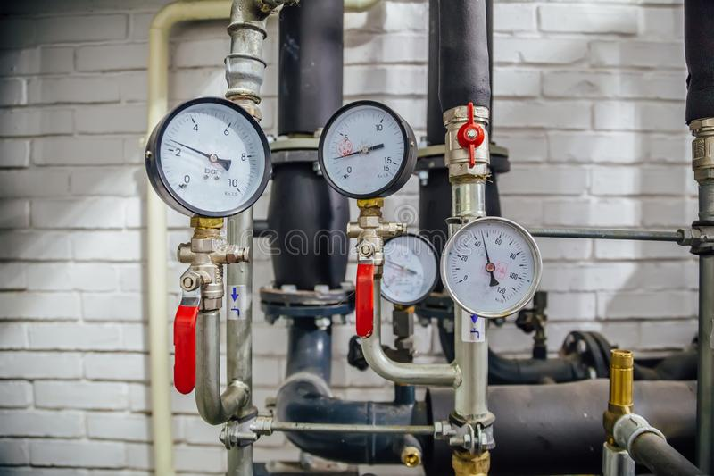 Steel pipeline of heating system with manometers.  stock images
