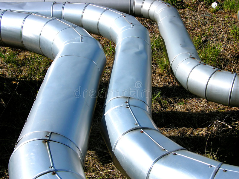 Steel pipeline in oil refinery. Three steel pipeline in oil refinery royalty free stock images