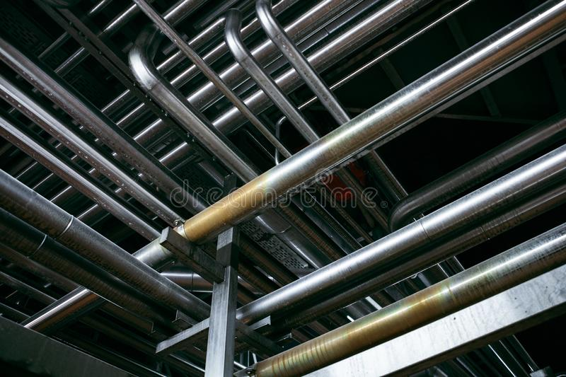 Steel pipelines on factory royalty free stock photo