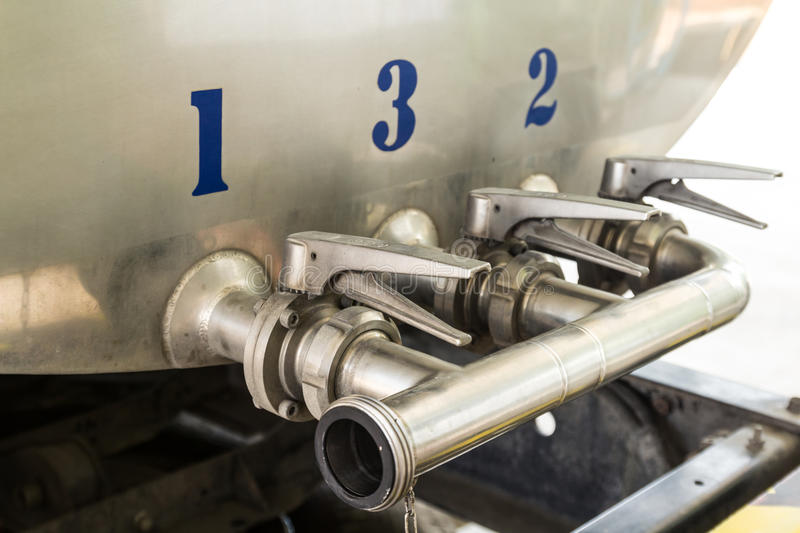 Steel pipelines and valves. On trucks transport raw milk stock photos