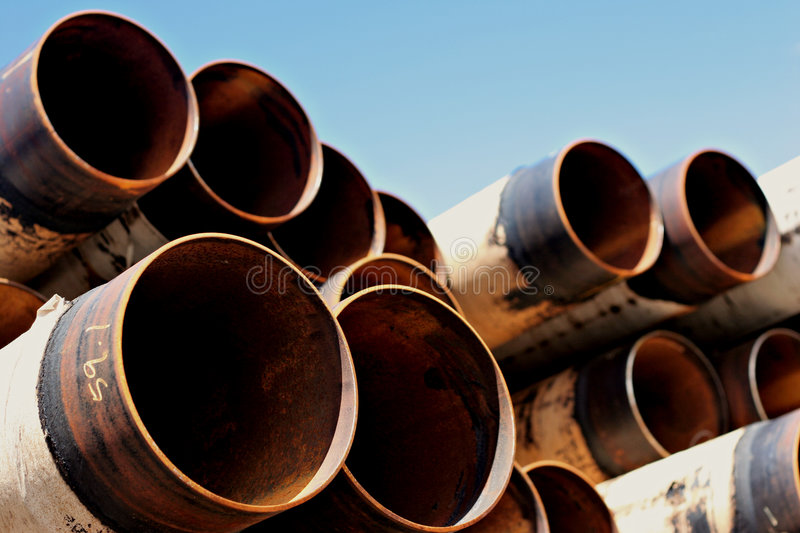 Steel pipes. A set of large, used and rusting steel pipes royalty free stock photography