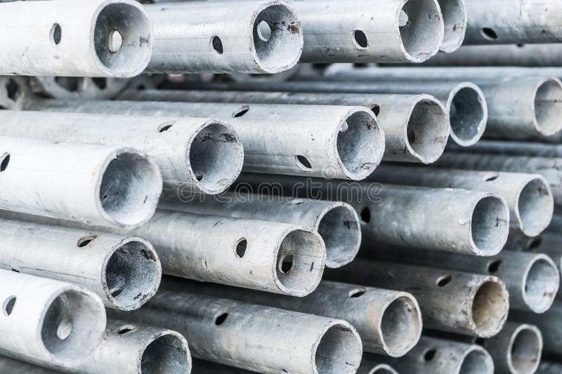 Steel pipes, construction industry concept - scaffolding parts. Closeup stock photos