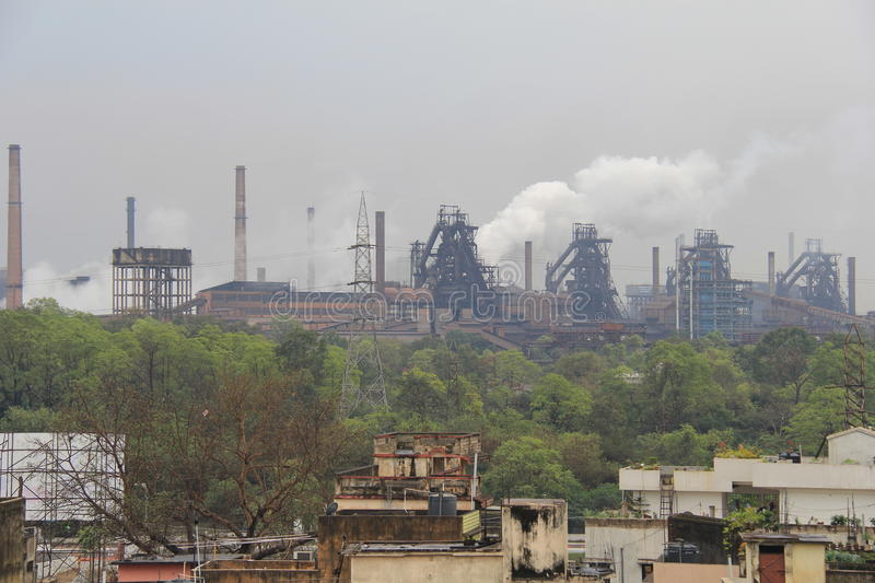 Steel Plant of Rourkela. Steam flows out from chimneys at Rourkela Steel Plant, India royalty free stock photos