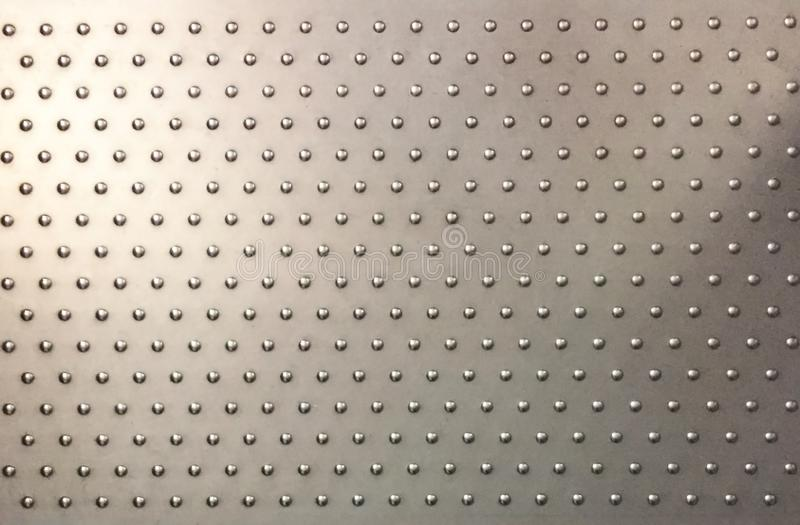 Steel plate with anti slip buttons royalty free stock image