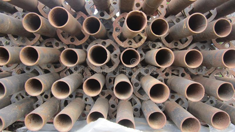 Steel supports for scaffolding racks. Steel poles for mounting scaffolding stock images