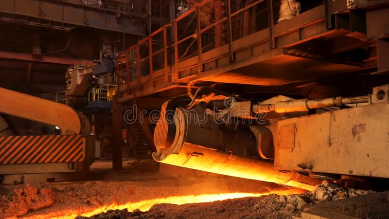 Steel production in electric furnaces, heavy industry concept. Stock footage. Close up for mechanism of the machine for stock images