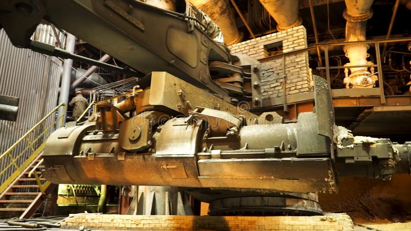 Steel production at the metallurgical plant, heavy industry concept. Stock footage. Close up for the bucket for feeding stock images