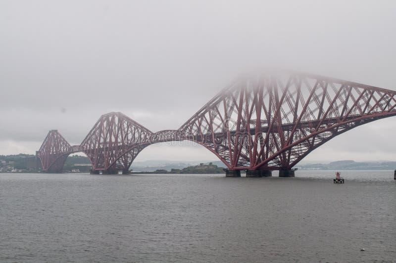 Steel rail bridge near Edinburgh. Old red steel railway bridge runs through the sea. It is just a short walk from Edinburgh, Scotland stock images