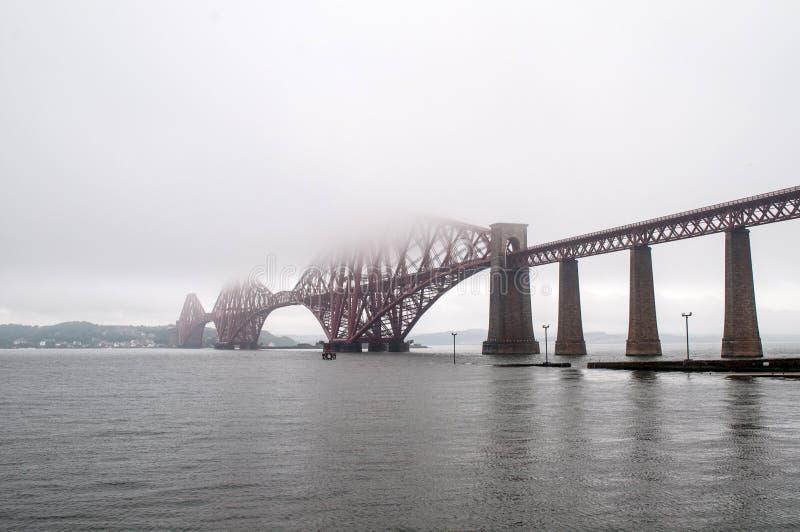 Steel rail bridge near Edinburgh. Old red steel railway bridge runs through the sea. It is just a short walk from Edinburgh, Scotland royalty free stock photography