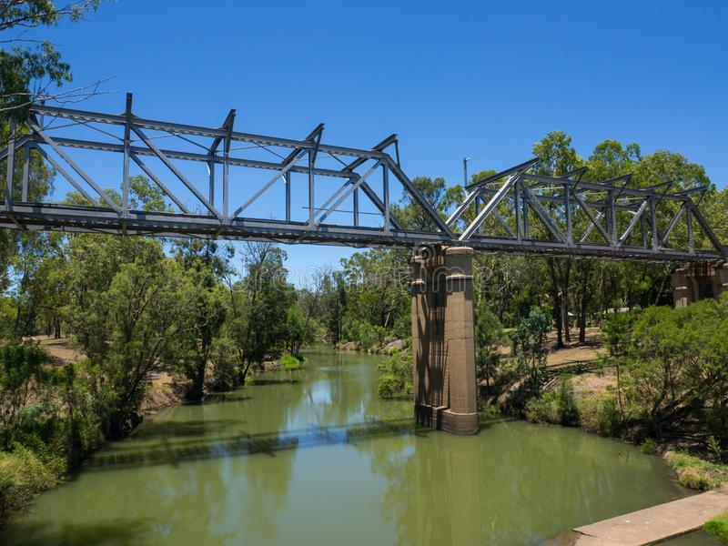 The Steel railway bridge across the small lake in Emerald, Queensland, Australia. Steel railway bridge across the small lake in Emerald, Queensland, Australia stock photos