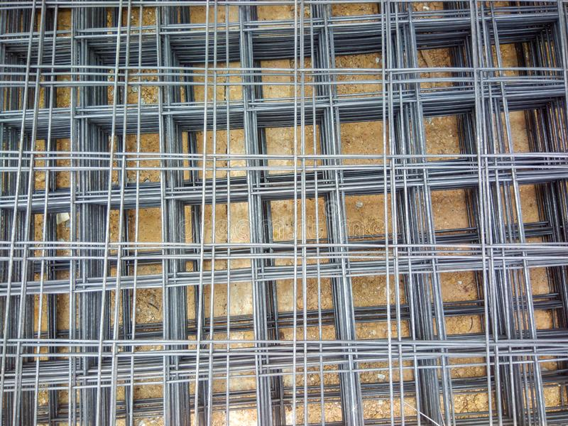 Steel reinforced rod for concrete in construction, Wire mesh steel for construction put a pile stock images