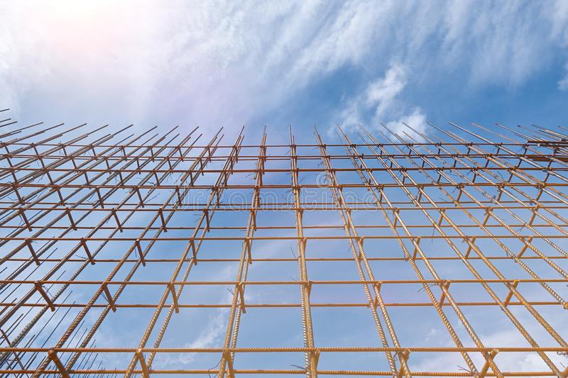 Steel reinforcement bar and timber form works at construction site on blue sky background. Steel reinforcement bar and timber form works at construction site on royalty free stock photography