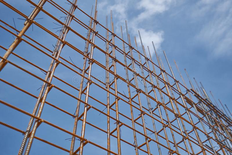 Steel reinforcement bar and timber form works at construction site on blue sky background. Steel reinforcement bar and timber form works at construction site on stock image