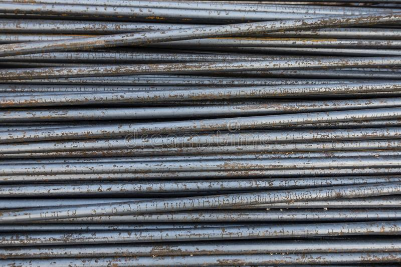 Steel rod outdoor with nature rust texture background. A steel rod outdoor with nature rust texture background stock image