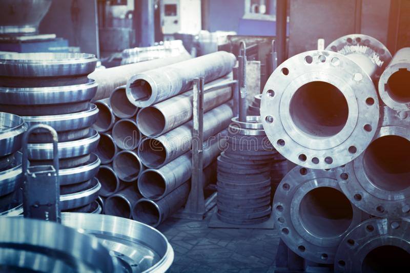 Steel rollers are blanks produced on a lathe from steel and cast iron. Many of the same parts fit into the factory floor. Expect further processing stock photography