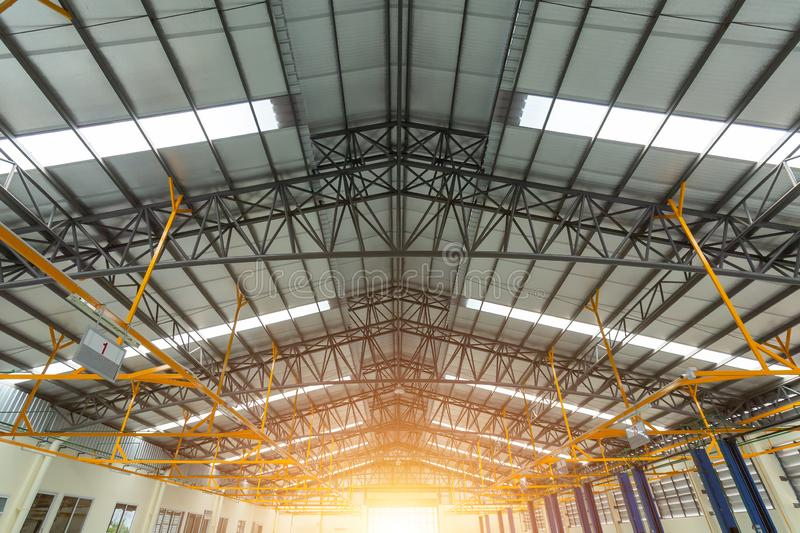 Steel roof truss in car repair center, Steel roof frame Under construction, The interior of a big industrial building or factory stock photos