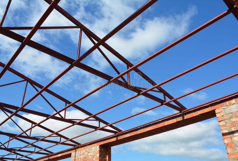 Steel roof trusses details. Steel roof trusses sitting on concrete pole view from inside home factory. stock photography