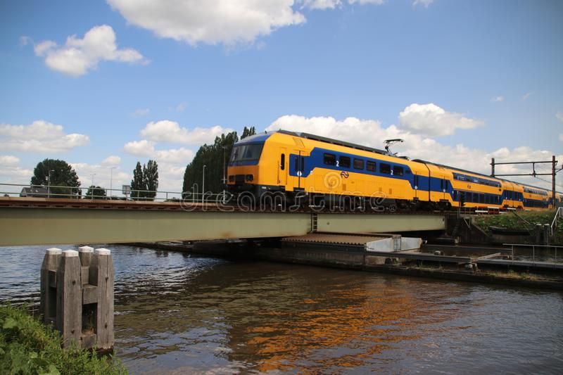 Steel Rotating bridge over the river Gouwe for trains at Alphen aan den Rijn in the Netherlands. Steel Rotating bridge over the river Gouwe for trains at Alphen royalty free stock photo