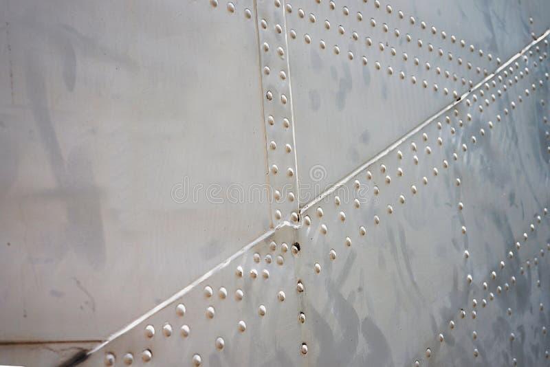 Steel Round Head Rivets in sheet aluminium body of aircraft royalty free stock photo