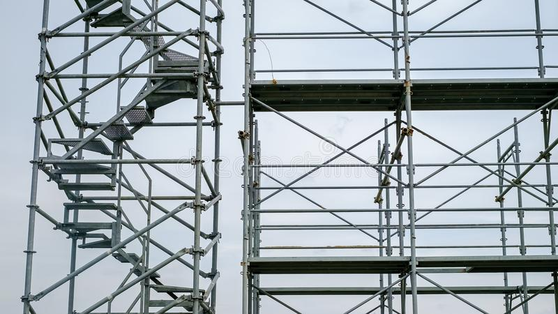 Steel scaffolding on cloudy sky. Close view stock images