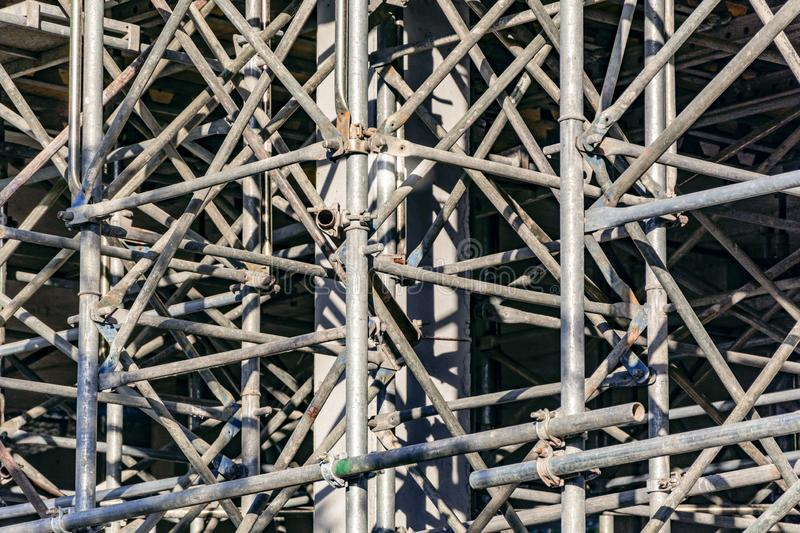 Steel scaffolding for the construction of a building. Construction activity stock photos