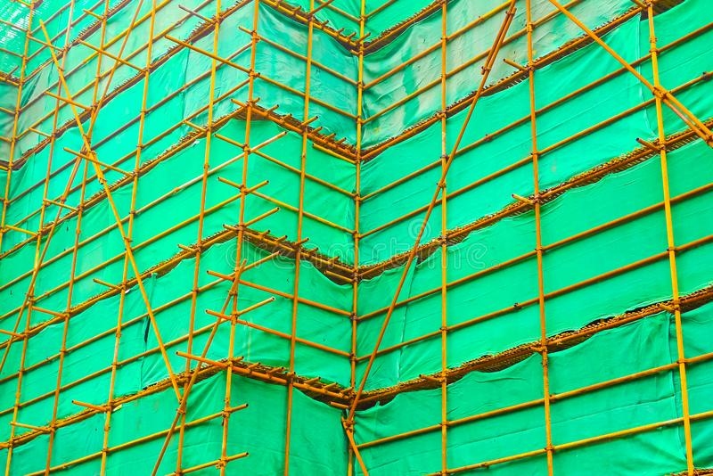 Steel scaffolding with a green curtain. In a construction site in Shanghai, China stock photography