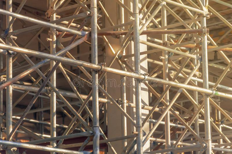 Steel scaffolding mounted for the construction of a building. Building activity. City and urban life stock photography