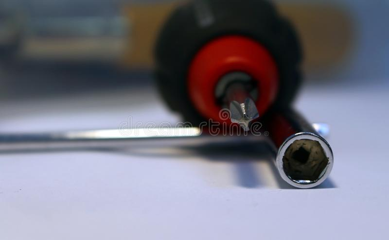 Steel screwdriver and Allen wrench. Closeup royalty free stock photos