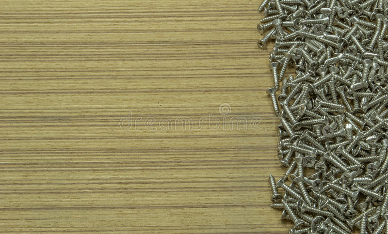 Steel screws. Steel on brown table for wood job stock photography
