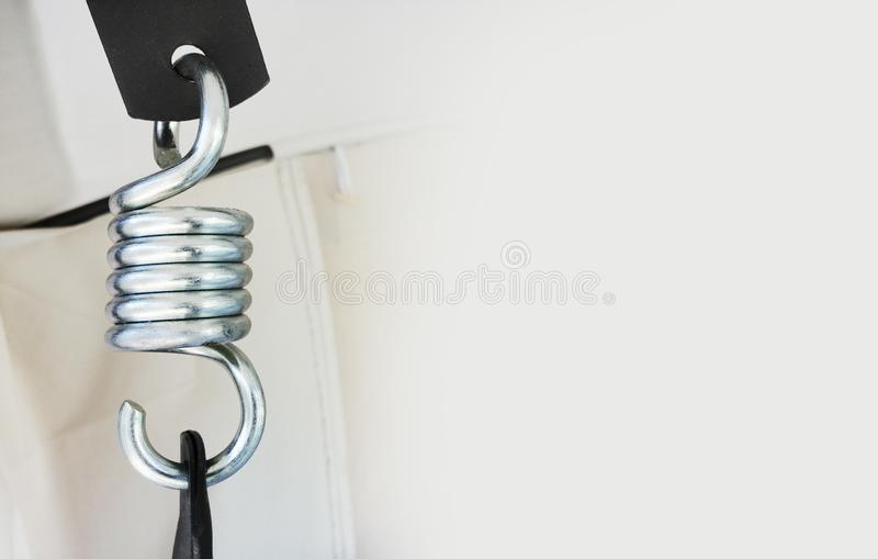 Steel spring for a swing. the idea is garden furniture. constituent structures, parts and fittings. empty space for text, banner. Steel spring for a swing. the stock photo