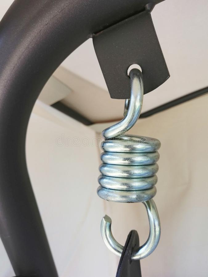 Steel spring for a swing. the idea is garden furniture. constituent structures, parts and fittings. Steel spring for a swing. the idea is garden furniture stock photography