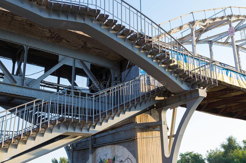 Steel staircase leading to the pedestrian bridge. Steel staircase with wooden steps leading to the pedestrian bridge across the Dnieper river. Dnepropetrovsk stock photos