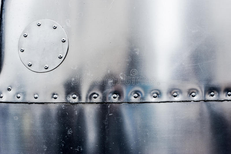 Steel stamped rivet background. With round patch royalty free stock image