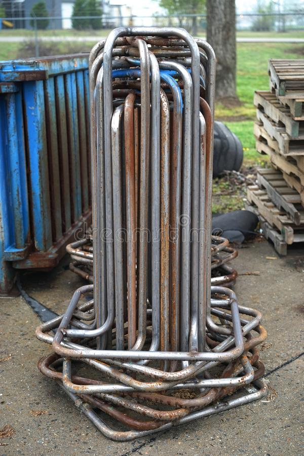 Steel stands for galvanized recycling wire. Recycling waste products such as paper, plastic and metal are packed into large cubes using baling wire before stock images